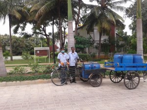 waste collectors with the tri-cycles used for collection